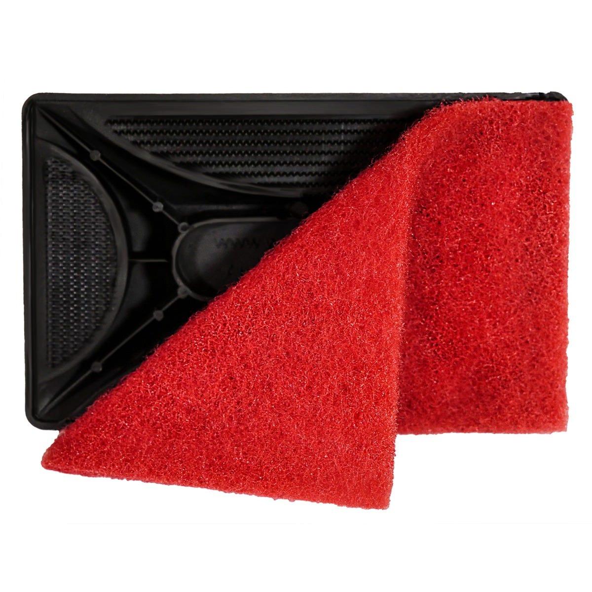 Cooktop scrubbing pad up close